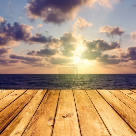 Photo for Empty wooden deck floor over sea and sunset background - Royalty Free Image