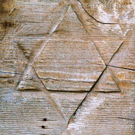 David star cut on wooden surface