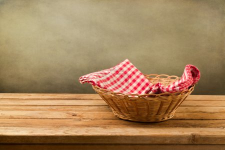 Empty basket with checked tablecloth
