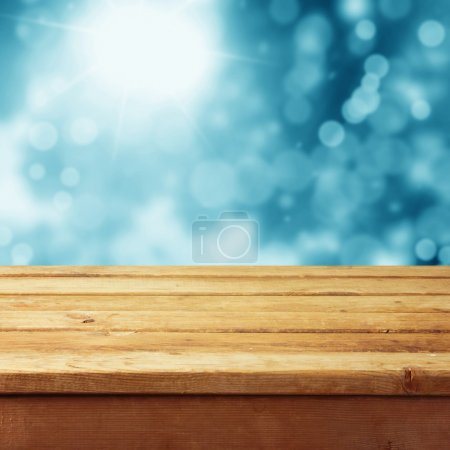 Deck table with winter bokeh background