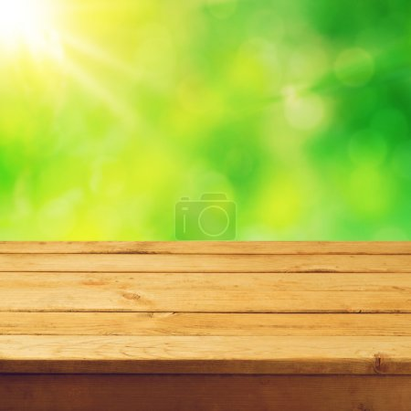 Deck table with foliage bokeh background