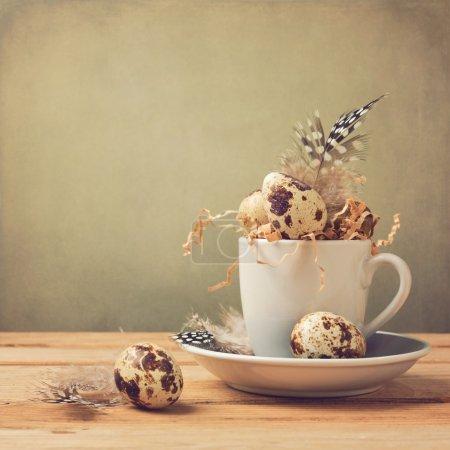Quail eggs in coffee cup