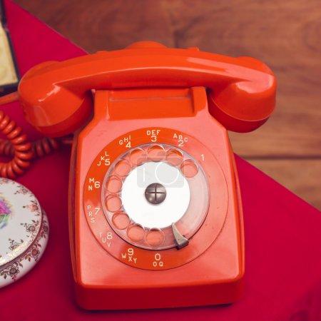 Vintage rotary telephone on table