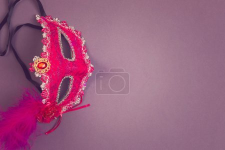 Photo for Carnival mask on purple background with copy space - Royalty Free Image