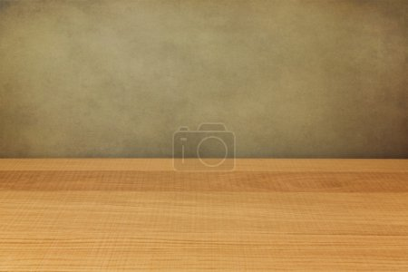 Empty wooden counter over grunge wall