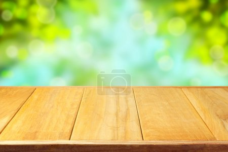 Wooden table over bokeh background