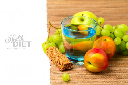 Photo for Diet concept. Water, healthy snack bar and fruits over white background - Royalty Free Image