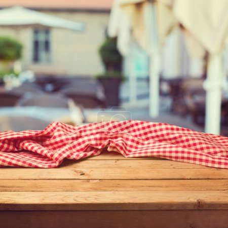 Photo for Table with cloth over restaurant blur background - Royalty Free Image