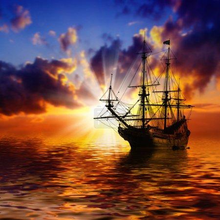 Sailboat against red landscape