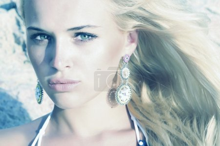 Beautiful blond girl. beauty woman. stone background