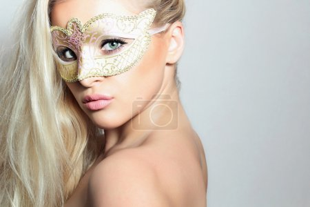 Beautiful Blond Woman in Carnival Mask. Holiday Masquerade. Sexy Girl