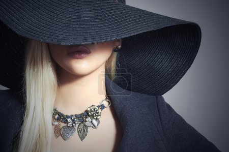 Beautiful Blond Woman in Black Hat.Elegance Beauty Girl.Spring Shopping.Lady in Jewelry