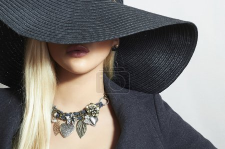 Beautiful Blond Woman in Black Hat. Close-up. Eleg...