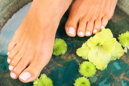 Photo for Beauty treatment photo of nice pedicured feet - Royalty Free Image