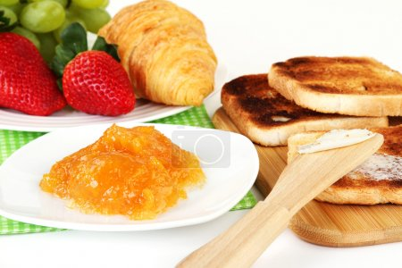 Photo for Table Breakfast - Continental Breakfast, fruit, jam, and toast. - Royalty Free Image