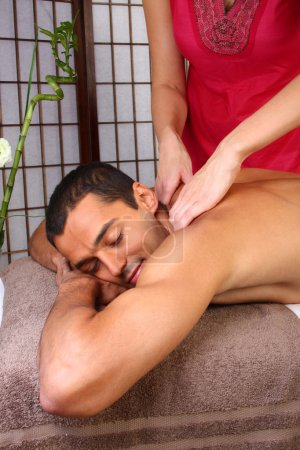 Photo for Young man receiving massage - SPA - Royalty Free Image