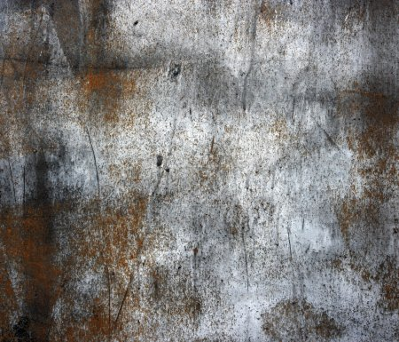 A rusty old metal plate with cracked black gloss paint. Old rust