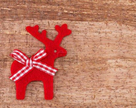 Christmas Reindeer on wooden background