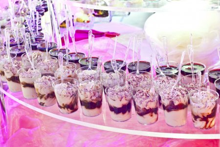 sweet buffet on a pink table in a party
