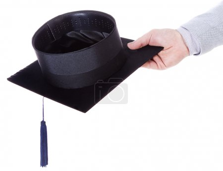 mortarboard academic graduation cap in the hand