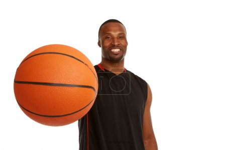 Happy young basketball player with focus on the ball
