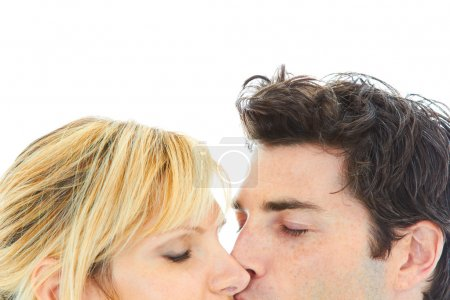 close up portrait of young couple kissing