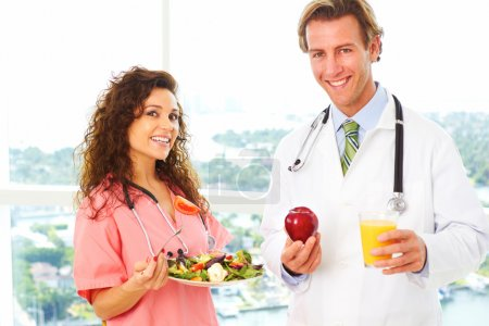 Nurse and Doctor with health food