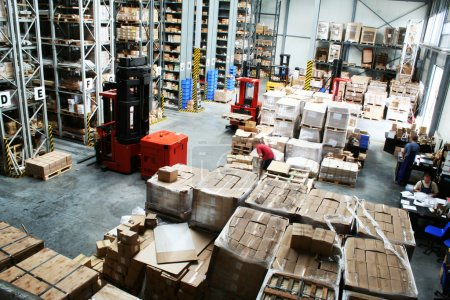Photo for Full warehouse with forklifts and lots of packages - Royalty Free Image