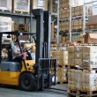 Busy warehouse with pallet trucks working...