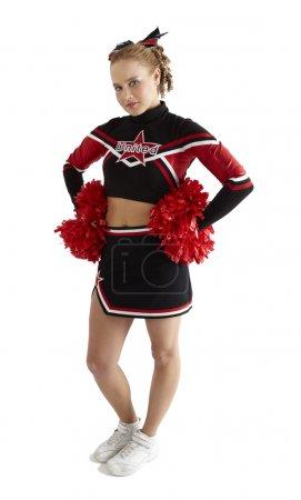 Photo pour Cheerleading poses avec deux pompons rouges en face de fond blanc - image libre de droit