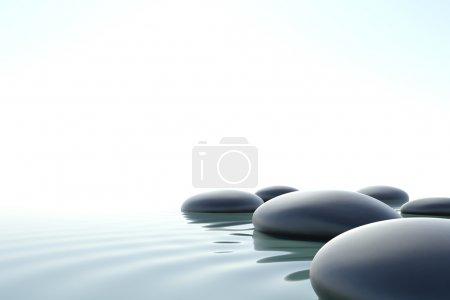 Photo pour Pierres zen dans l'eau sur fond blanc - image libre de droit