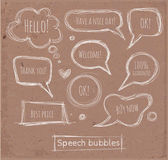 Sketchy speech and thought bubbles hand-drawn on brown paper.