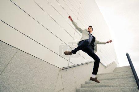 Man, model of fashion, jumping and wearing jacket and shirt