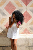 Young black woman, afro hairstyle, getting dressed