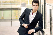 Young businessman in urban background