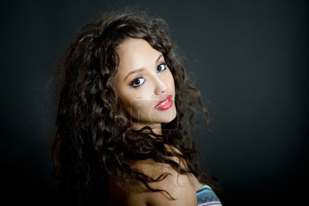 Attractive mixed woman on black background
