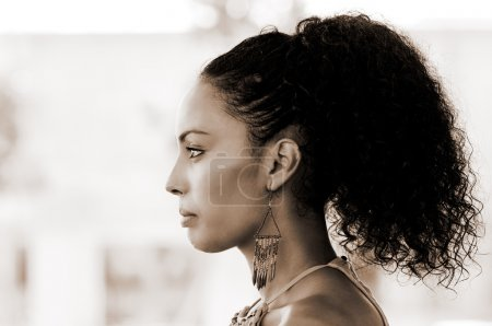 Black woman with earrings. Afro hairstyle