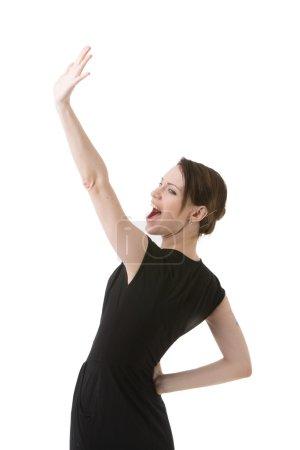 Photo pour Souriant Bonjour ondulant de jeune femme ou au revoir, isolé sur blanc. - image libre de droit