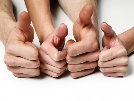 Group hands showing thumbs up