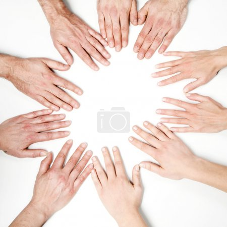 Photo for Hands of the group in circle on white - Royalty Free Image