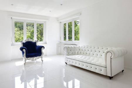 Photo for Leather sofa, armchair classical, in white room - Royalty Free Image