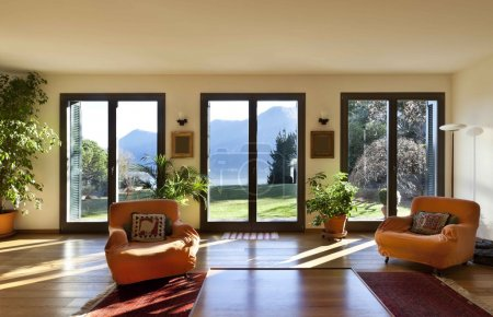 Living room with orange armchairs