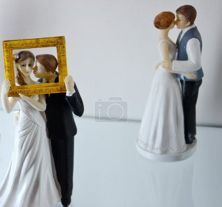 Photo for Brides and bridegrooms figures for a wedding cake on top - Royalty Free Image