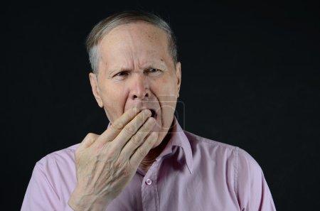 senior yawning