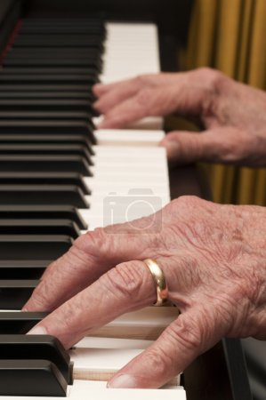 Old Hands on the Piano