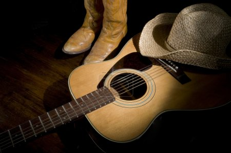 Photo for Spotlight on country guitar, boots and hat - Royalty Free Image