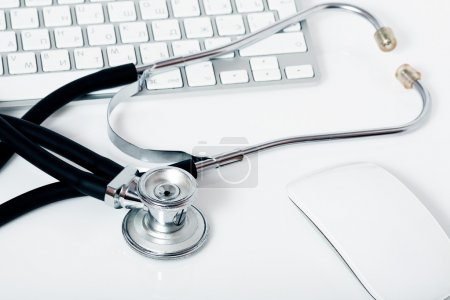 medical stethoscope, keyboard and mouse