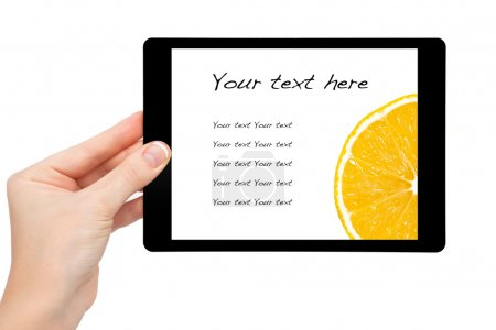 Woman hand hold a mini tablet with orange on a screen