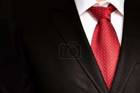 Photo for Businessman in a black suit with a red tie - Royalty Free Image