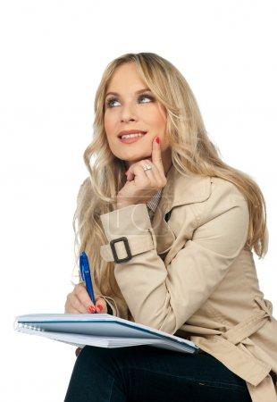 woman writing notebook